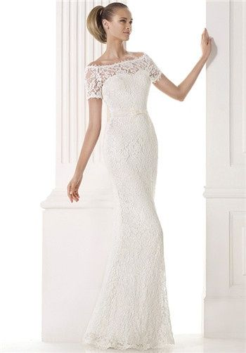 Straight lace wedding dress with sheer, off-the-shoulder layer over a sweetheart neckline. Short sleeves