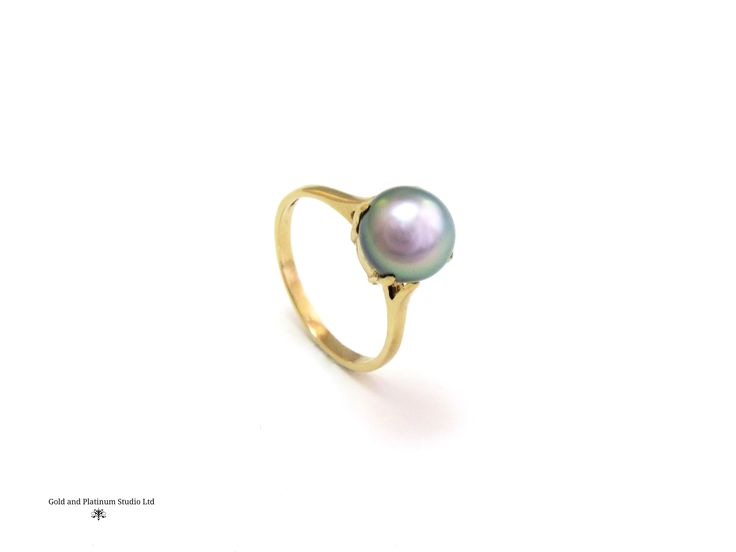 Tahitian pearl set into a yellow gold mount.