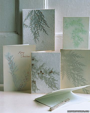 Evergreen Cards  The silhouettes of evergreen sprigs adorn homemade greeting cards; a light layer of white spray paint highlights the shape of the branches against the colored paper. With a bit of glue and touches of glitter, you can create your own sparkling messages