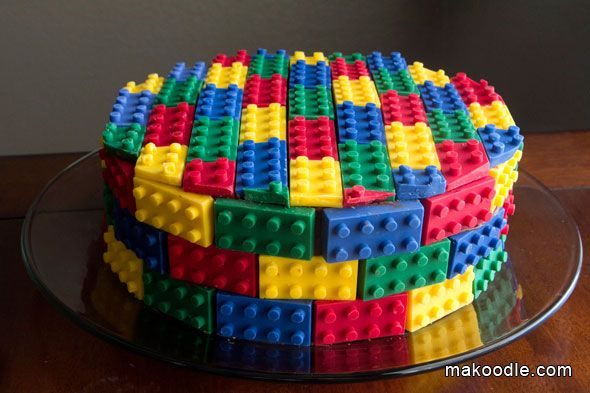 Lego Cake. Topped with edible chocolate Lego bricks. Wow.