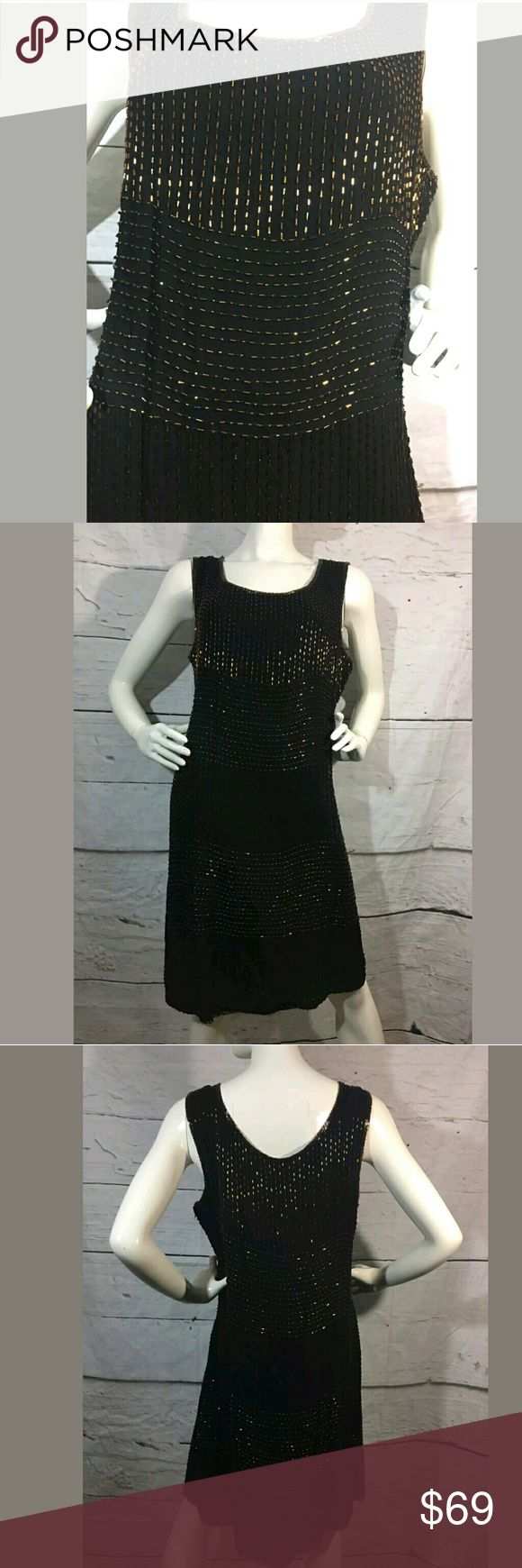 NWOT Beaded Cocktail Flapper Style Dress NWOT Women's Beaded Cocktail Flapper Style Dress Black Gold Size 18 New.  No tags, but bag with extra beads is attached.  LB Styleworks Dresses