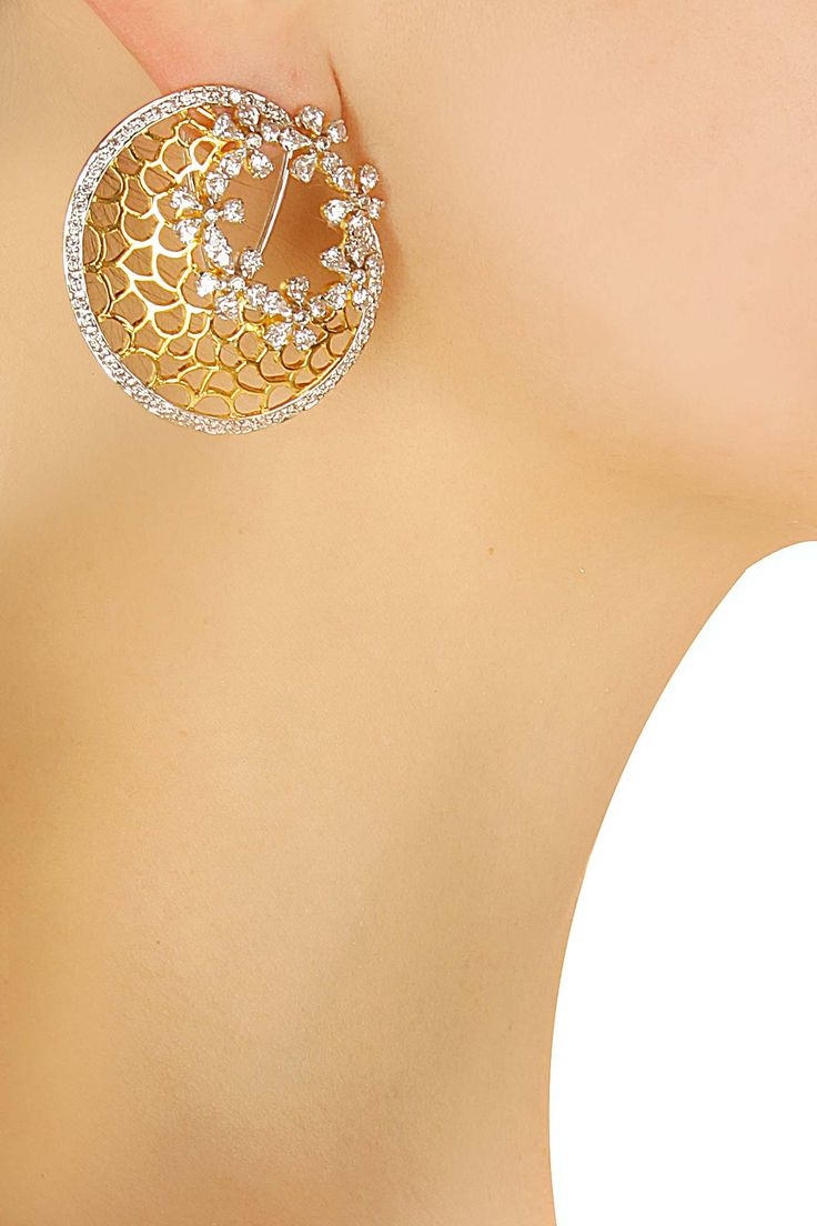 Gold finish flower round earrings by Shrruti Tapuria for Whatever. Shop now…