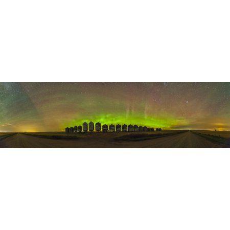 Aurora borealis behind grain bins on a country road in Alberta Canada Canvas Art - Alan DyerStocktrek Images (51 x 15)