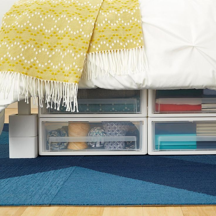 "Enjoy free shipping on all purchases over $75 and free in-store pickup on the Under Bed Drawer at The Container Store. An oversized capacity makes our Under Bed Drawer an oversized solution for storing out-of-season clothes, kids' artwork, toys, linens, blankets, and shoes under the bed.  It's also stackable for use in the closet, garage or laundry room - we show two here. The drawer glides smoothly and is clear for visibility.  Line these under bed drawers with <a href=""..."