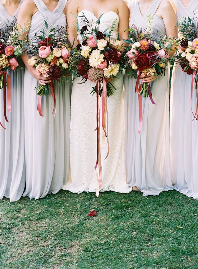 pale lavender bridesmaid gowns against bold deep burgundy and pink bridal bouquets, photo: austin gros