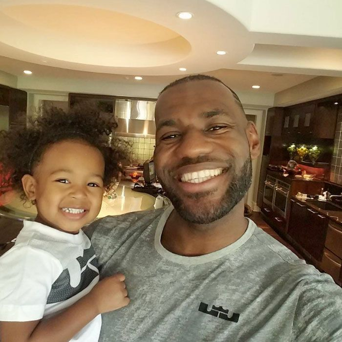 """LeBron James flashed a bright smile in honor of his daughter Zhuri's birthday. Alongside the happy photo the NBA star wrote, """"Happy 2nd perfect beautiful birthday Princess Z!!! You're amazing in every aspect of life and I'm happy to be your Dada. Love you through my existence and beyond! #DaddysGirl #YourSmileInspiresMeEvenMore #SorryForPuttingYouOnSocialMedia #IKnowYouHateItButItsASpecialDay.""""    Photo: Instagram/@kingjames"""