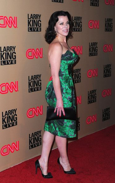 Debi Mazar Evening Pumps - Debi Mazar donned black satin pumps with rosette embellishments. The heels were the perfect complement to her emerald green cocktail dress.