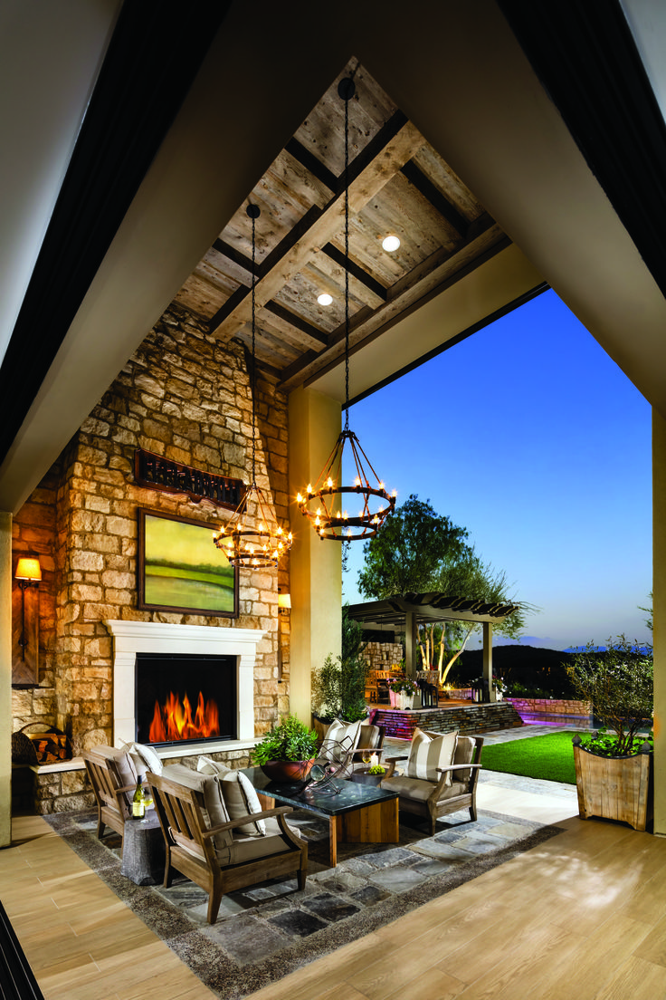 Seamless outdoor living featuring Heatu0026GloFireplaces from our