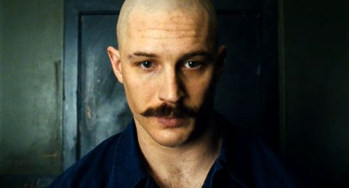 TH0030A - Bronson (2008) / Tom Hardy as Charles Bronson / Michael Peterson. A young man who was sentenced to seven years in prison for robbing a post office ends up spending three decades in solitary confinement. During this time, his own personality is supplanted by his alter-ego, Charles Bronson