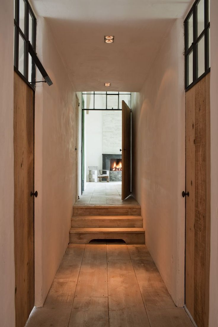 Reclaimed wide plank floors and door. Black framed transoms. Stone Fireplace. Natural Beauty.