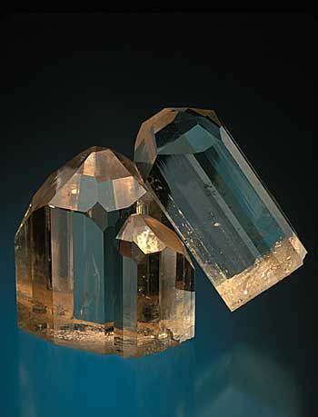 Magnificent intergrown brown topaz crystals from the Mogok region of Burma. 8.5 cm. high. William Larson collection. Photo: Jeff Scovil