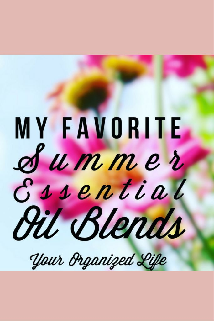 """Soft focus picture of flowers with the title """"My Favorite Summer Essential Oil Blends"""" superimposed over the picture."""