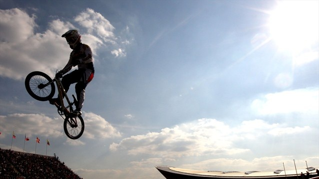 A rider clears a jump during the men's BMX Cycling quarter-finals on Day 13 of the London 2012 Olympic Games.