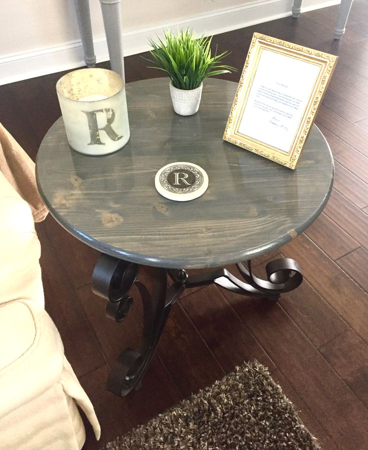"Repurposed glass table top with metal base.  Metal repainted with rubbed bronze spray paint.  24"" inch round pine top from Lowes painted stained with gray Minwax stain.  Clear coat Minwax semi-gloss fast drying water based polycrilic."