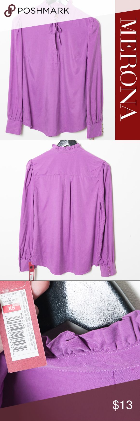 NWT Merona Long Sleeve Top Violet XS New with tags XS Merona top in Hyacinth Violet (purple). Long sleeves with three buttons on each sleeve. Ruffle neck with bow and buttons. 68% modal, 32% polyester. Machine wash cold, gentle cycle. Tumble dry low, cool iron if needed. Merona Tops Blouses
