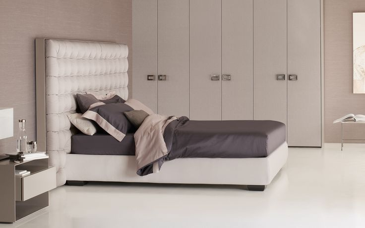 "A headboard in satin, trimmer in leather with a luxurious quilted finish… [Letto matrimoniale / Double Bed ""Sanya"" by Carlo Colombo for #Flou] #Beds #Bedroom #Letto #InteriorDesign #HomeDecor #Design #Arredamento #Furnishings #White #Letti #Beds #TotalWhite #GreyandWhite"