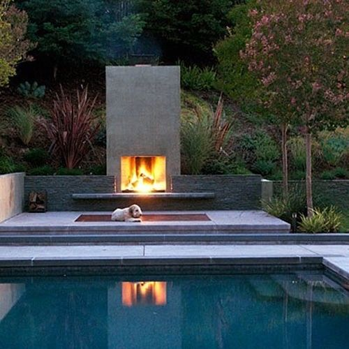outdoor fireplace by the pool
