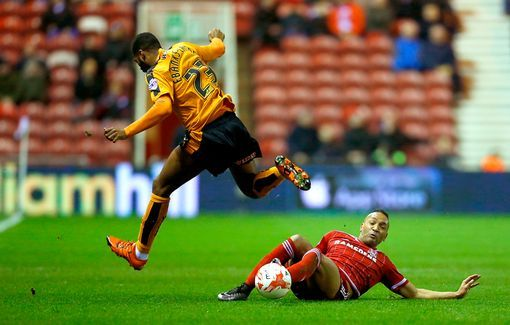 Wolves' Ethan Ebanks-Landell is tackled by  Emilio Nsue