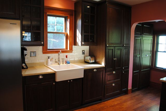Traditional IKEA kitchen with farmhouse sink, integrated dishwasher, mixer lift