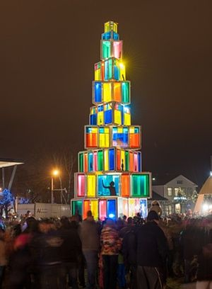 People visit a12 meter high Christmas tree constructed of 121 old windows that come from local old houses as it is illuminated in Rakvere, Estonia.