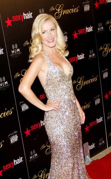 Angela Kinsey Evening Dress - Angela Kinsey arrived at the Gracie Awards Gala looking ultra-glamorous in a gold ombre beaded halter gown.