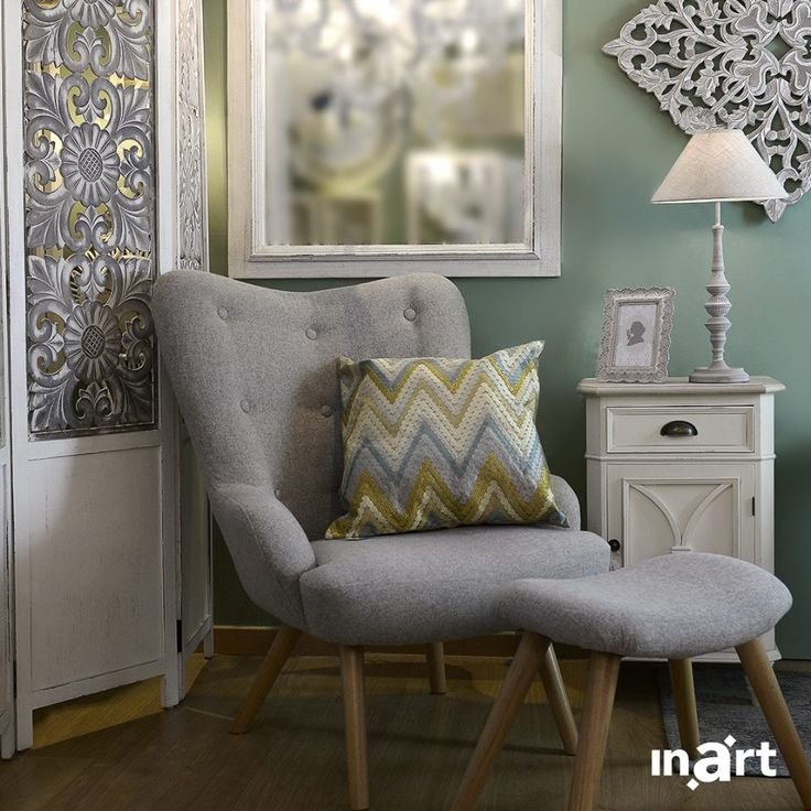What is this cute little pillow doing, placed on the elegant grey armchair? Our evening cozier! #inart #spring