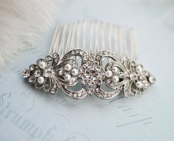 This vintage inspired, crystal and imitation pearl bridal hair comb makes a great accessory for your wedding day or gift for your bridesmaids! Set on a metal comb. MEASURES: 3 1/8 x 1 1/8 set on 2 wide metal comb (Metal comb used in shown in photo in the hand). Please note measurements prior to placing order. Available with or without pearls - select color at checkout. Pearl color photos: http://etsy.me/1KDv24G _______________________ IMPORTANT!!!! ❤ ❤ ❤ PROCESSING ...
