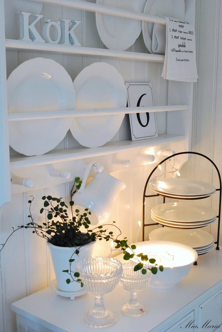 Narrow Shelves With Plate Rails, Plus A Prettily Lit Vignette Below