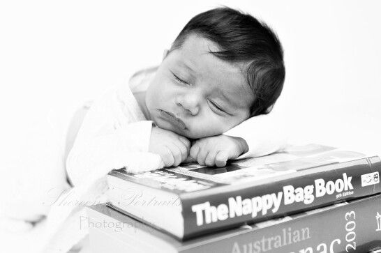 Newborn photo session. Baby on books.  Saved from www.shereensportraits.com