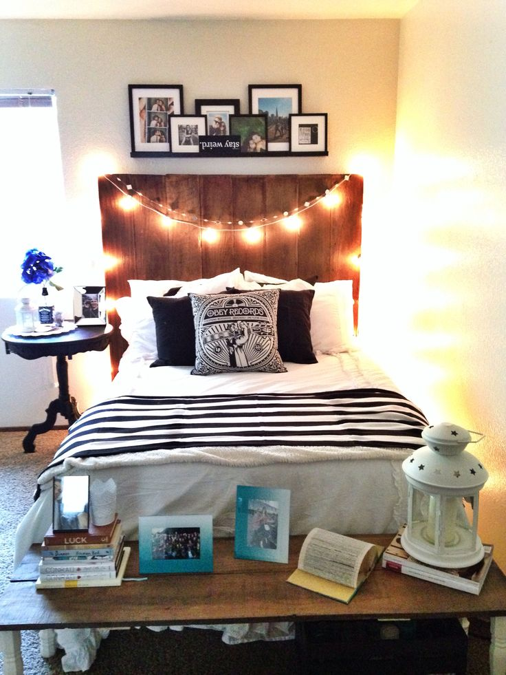Bedroom for first apartment. DIY headboard & bench made out of old fencing. Re-painted bed-side table. Interior design at it's finest.