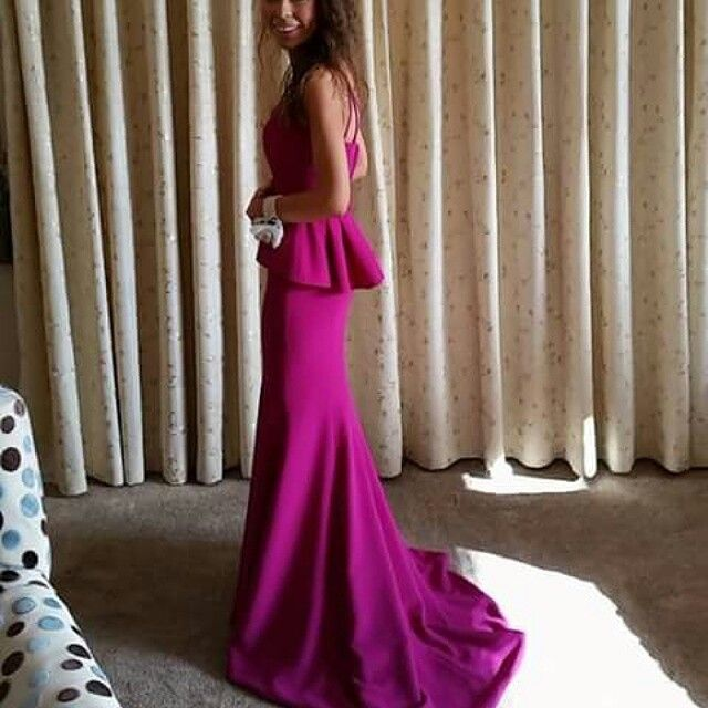 Evening gown in fuschia crepe made by Geraldine O'Meara designs