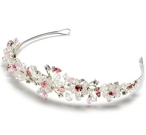 Passion Pink Tiara explodes with sparkle and shine! A beautiful hand-made tiara that contains a mixture of clear and pink crystal beading.