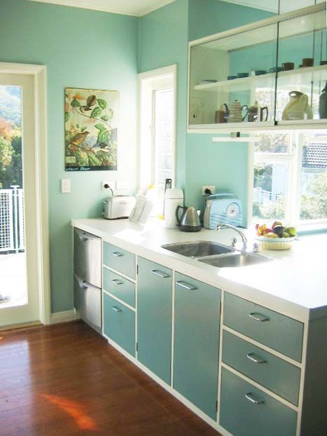 Favorite: glass two-sided shelves above sink, turquoise color, cabinet style, counter, layout
