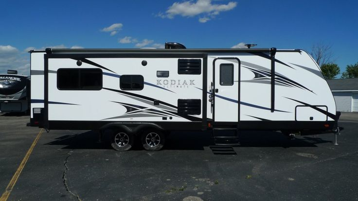 """LIGHTWEIGHT, LUXURIOUS, & LEADING EDGE!!  2017 Dutchmen Kodiak 291RESL Have Thanksgiving at your place this year- in your RV, that is! That's right, the kitchen in this 32' 4"""" long, 6536 lb. RV can handle everything from a holiday feast to a four-course meal! Stainless steel appliances and solid surface countertops supply plenty of cooking power and space for meal prep! Give our Kodiak expert Norman Wells a call 231-730-3481 or send an email to norm@natlrv.com for pricing and more…"""