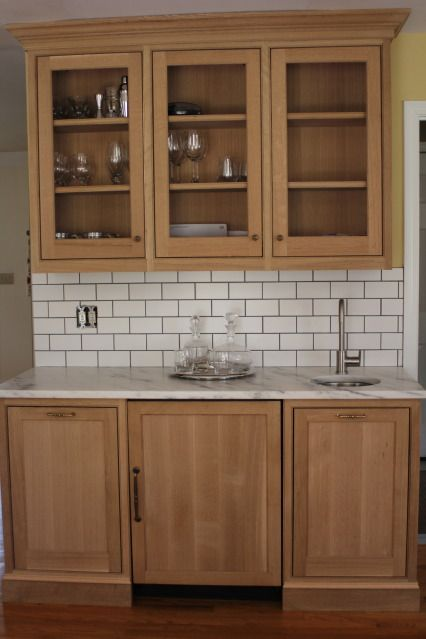 subway tiles so they do look good with oak our perimeter and fridgeovenpantry and wet bar are all quarter sawn oak the island is paint grade maple