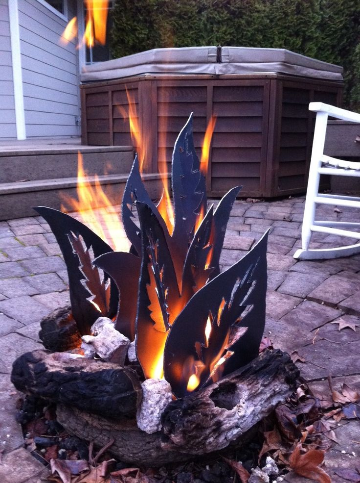 "backyard fire pit with metal ""fire""........piece of art"