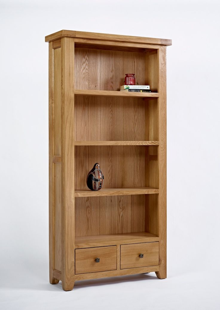 Devon Oak Large Bookcase - The Devon Oak Large Bookcase has three chunky shelves creating four ample shelf spaces, ideal for displaying a variety of living room paraphernalia. Complimentary in a range of settings, the Devon Oak Large Bookcase is crafted using traditional techniques investing the structure with a long-lasting stability. The oak of this piece displays individual textures and grain patterns which means you can be assured you are making a unique investment.