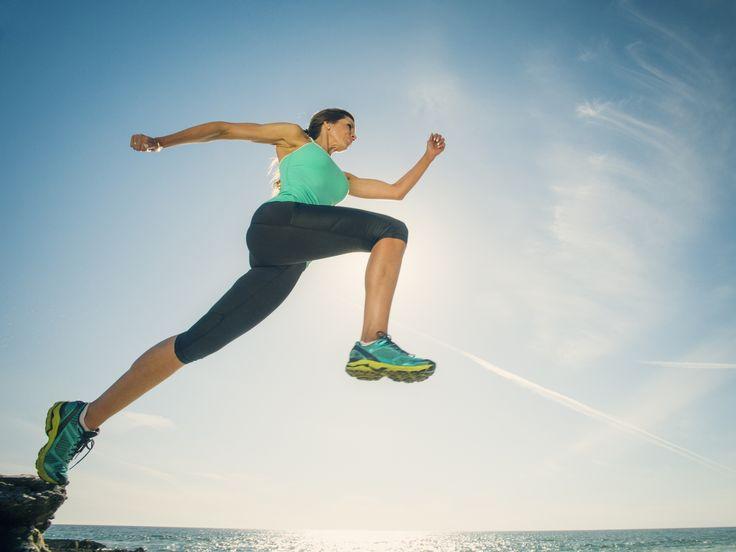Caucasian woman running on beach - Caucasian woman running on beach