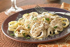 Creamy sauce, succulent chicken, perfectly al dente pasta, a sprinkle of fresh herbs...all that's missing is the waiter and the check.
