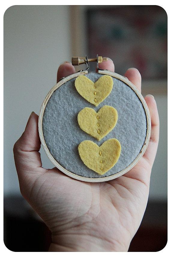 DIY. Embroidery Hoop Art, Three Yellow Felt Hearts.