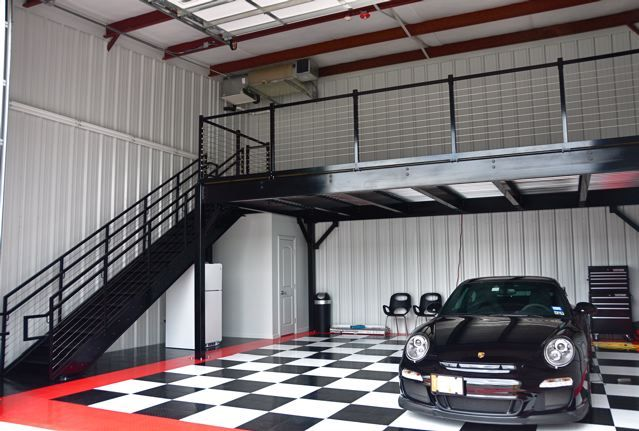 Photo gallery of garage condos with cars rvs and boats for Garage mezzanine ideas