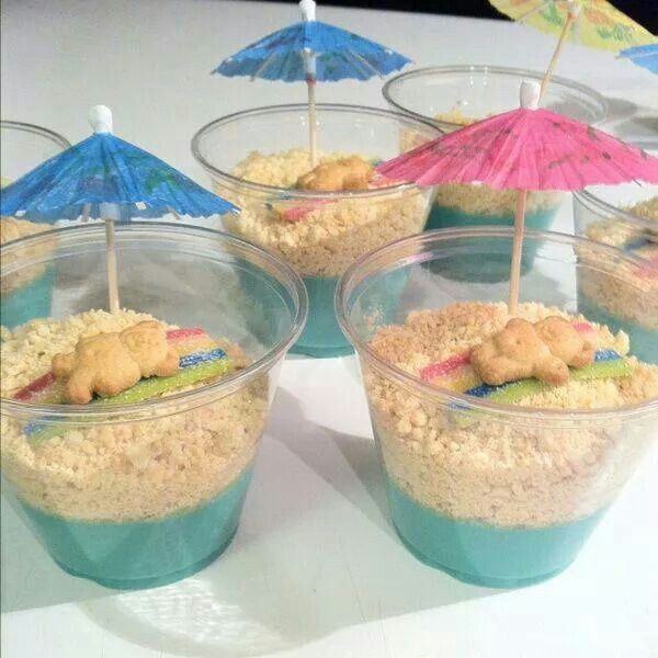 Beach Scene Dessert Cups - blue pudding or Jell-o, crushed up vanilla cookies, piece of fruit roll up for beach towel and a teddy graham - so cute! maybe any pudding w/ blue whipped cream?