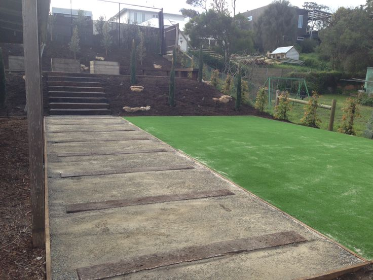 Railway sleeper treads and stairs with astro turf Sorrento
