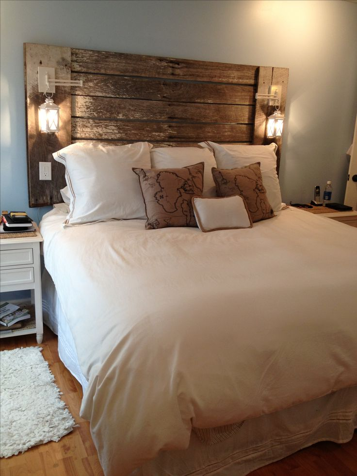 The headboard my husband made me out of reclaimed barn lumber and candle  lanterns. Love  Headboard IdeasDiy HeadboardsDiy ...