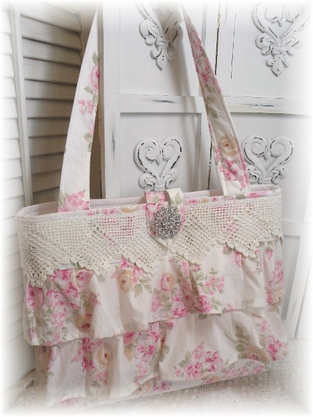 pretty bag - I may try my hand at making it.  Just longer for Church bag