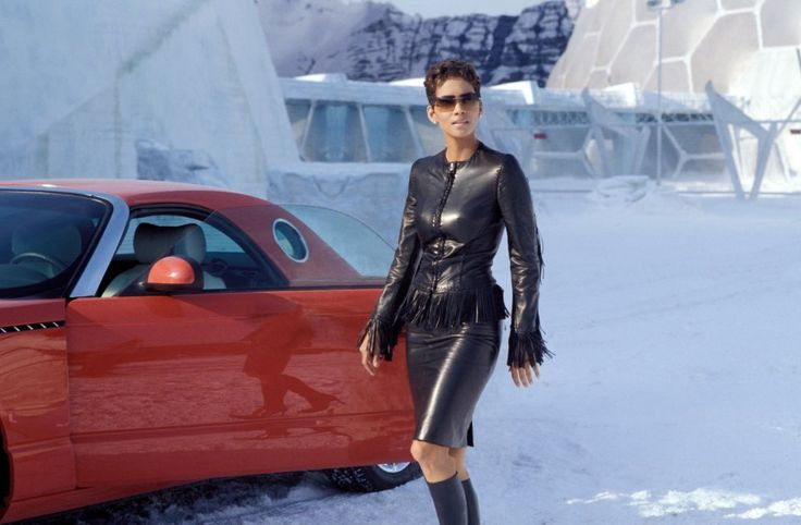 In Die Another Day (2002), Halle Berry bucks the fur trend with this black leather combo, complete with cowgirl tassle trim. She may have cold knees though.