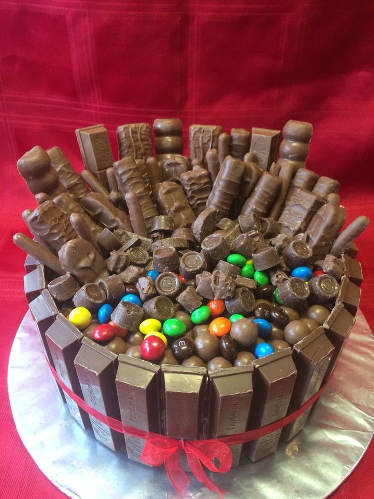 My husbands birthday cake, pure chocolate lushesness. All you can eat choc sponge, Nutella and all of your fav chocs layered with Cadburys Crunchie, Twix, and Double Decker in between yum, yum! Made by me Elena Purton