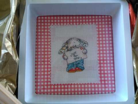 this cute rabbit has been cross stitched and mounted onto gingham paper and framed in a white frame. Tulipacious Designs.