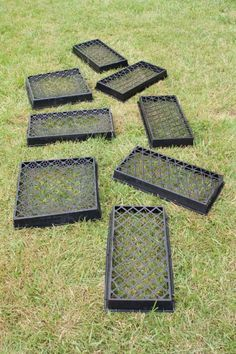 Directions for Easy Concrete Stepping Stones using old plant trays. never saw square ones, but maybe pizza boxes? Angled checkerboard grid for more interest.