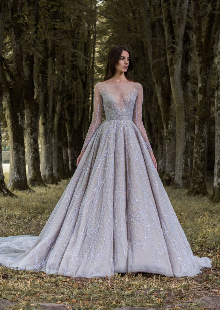 Dusky lavender gossamer wing-inspired long sleeved wedding ball gown by Paolo…